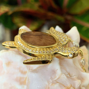Close up  of Koa cubic zirconia pave turtle in 14K gold plating over sterling silver.
