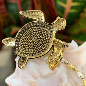 Close up of back of Koa cubic zirconia pave turtle in 14K gold plating over sterling silver.