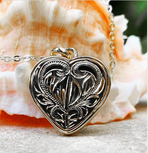 "Koa Aloha Heart with 18"" Adjustable Chain closeup of back scroll design in silver"
