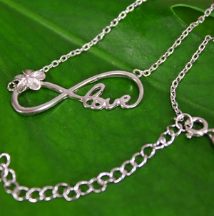 Plumeria Infinity Love Pendant Closeup with chain extension