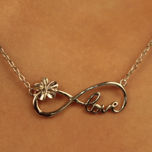 Plumeria Infinity Love Pendant Closeup on Model