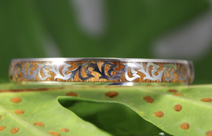 Koa Scroll Fish Hook Stainless Steel Bangle closeup