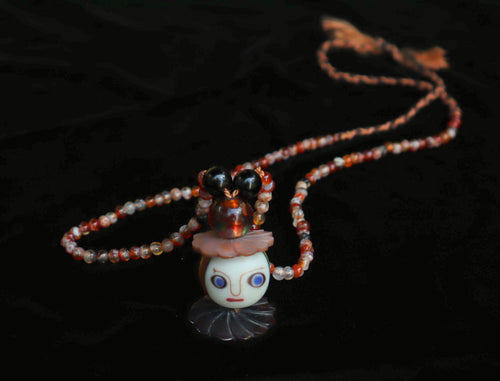 114 Face bead and carnelian necklace