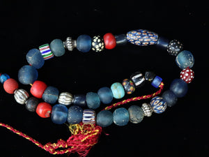 35 A strand of old and ancient beads.
