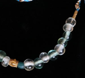 44 Rock crystal and gold beads
