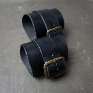 two custom Black leather Cuffs gauntlets with brass hardware wrist support back view - Heyltje Rose Shop