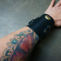 custom Black leather Cuff gauntlet with brass hardware on tattooed model - Heyltje Rose Shop