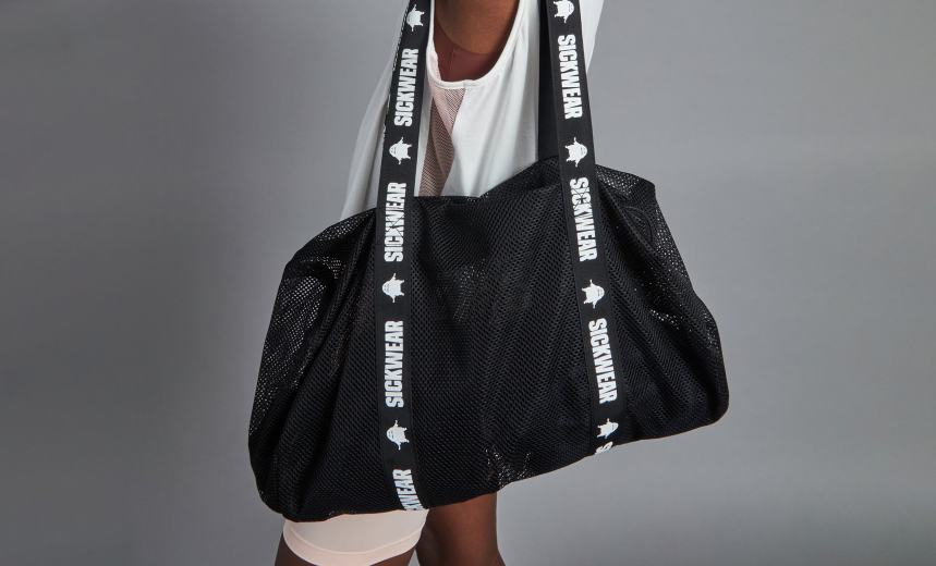 Black mesh duffel bag with a handle that says SICKWEAR