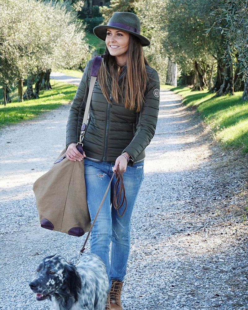 Fella Linen Travel Bag by GT Outdoors Italy with designer Giulia Taboga wearing Lussari Down Jacket and in Green and Selva Loden Hat with English Setter hunting dog
