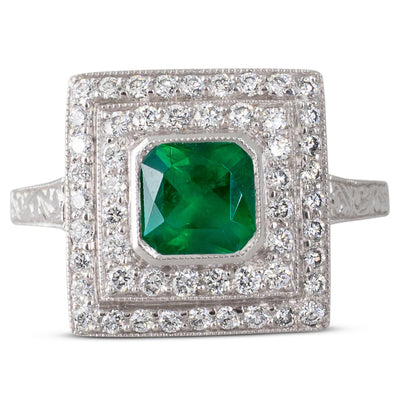 An Emerald & Diamond Cluster Ring
