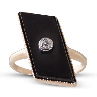 An Onyx & Diamond Ring