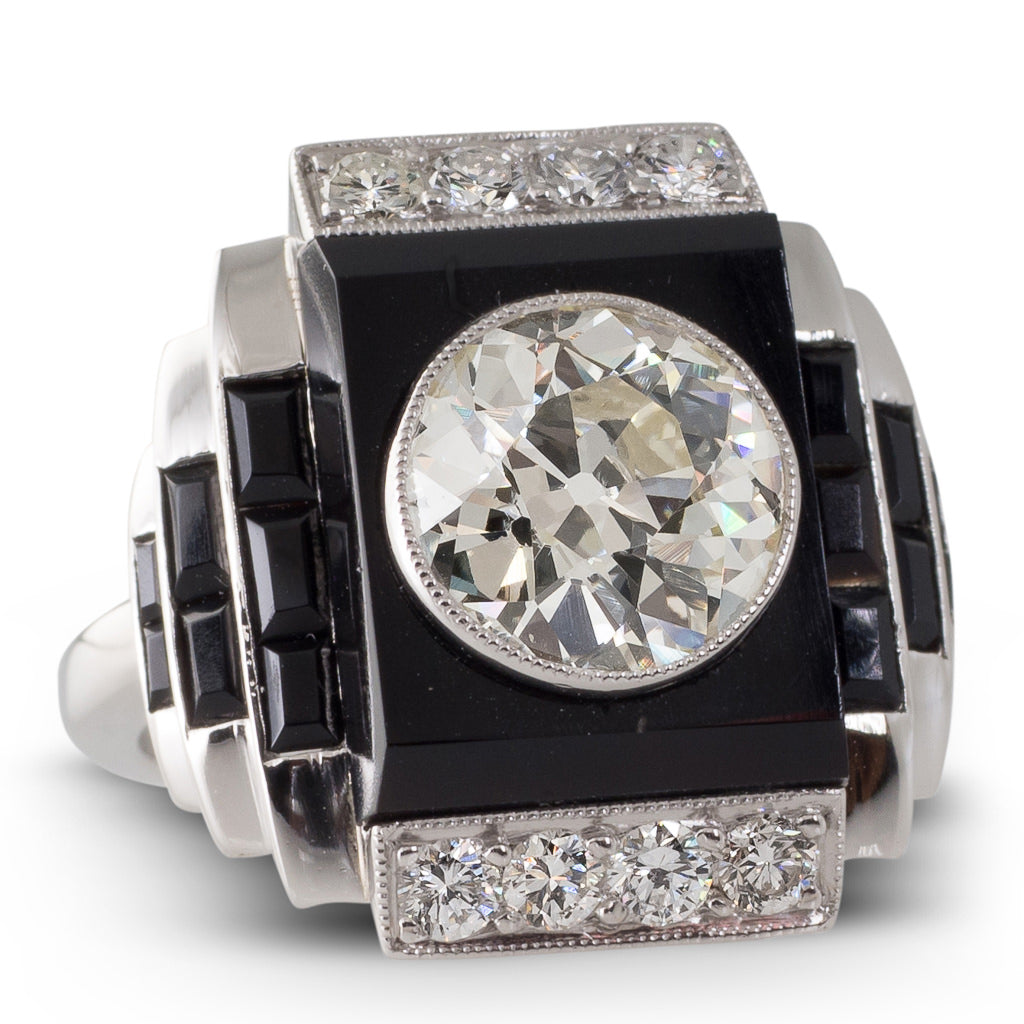 An Onyx & Diamond Plaque Ring