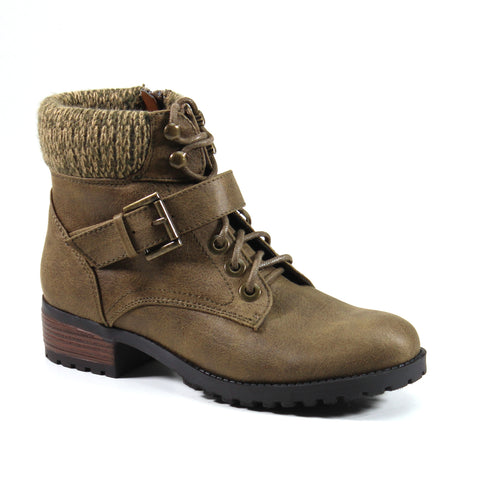 A vegan leather hiking bootie with a sweater collar that surrounds the topline. A faux lace-up design compliments the vegan leather upper fitted with buckle detail that sits across the vamp. An easy inside entry makes this style an instant favorite in your wardrobe.