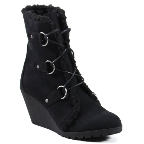 This imi suede upper compliments the shearling lining with shearling lined wedge bootie with D-ring ornaments and a gilly-tie front lace-up compliment the imi suede upper so well.