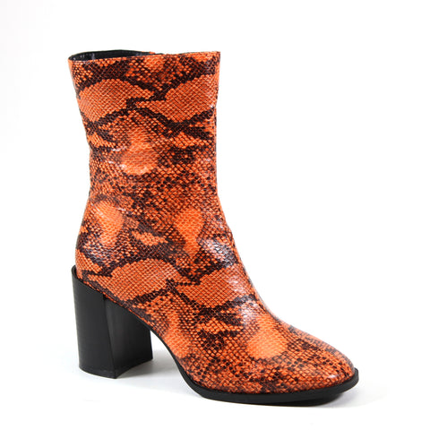 Midcalf block heel bootie with inside zip and vegan leather orange snakeskin upper. A perfect staple for your closet this season.