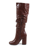 A DANA by Diba London is a mid-length slouch boot perfect for your casual or work looks.  Chocolate Vegan Leather or Tan Immi Suede covers the upper with an almond toe finish. Instant, effortless style with a self-covered block heel and partial inside zipper for a polished look when you step out in style.