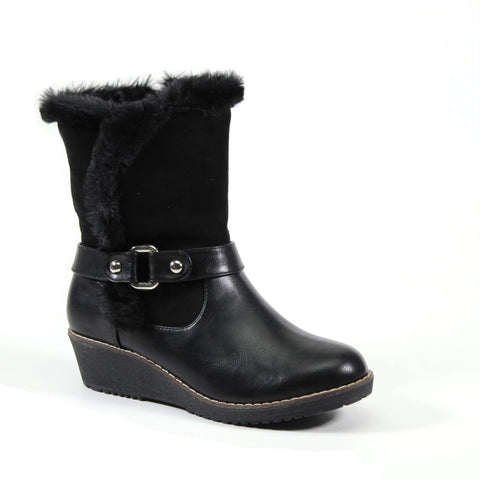 A cute and comfy wedge faux fur boot with ring strap ornament and inside zipper entry. Contrasting colors of black vegan leather and vegan suede make a stylish upper that leads to a vegan fur trim that surrounds the topline.