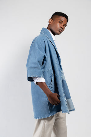 Distressed denim kimono in a medium wash