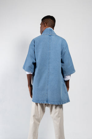 Men's distressed denim kimono in a medium wash