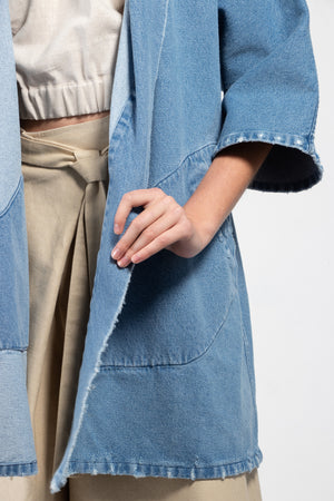 Hand sanded distressed denim kimono in a medium wash