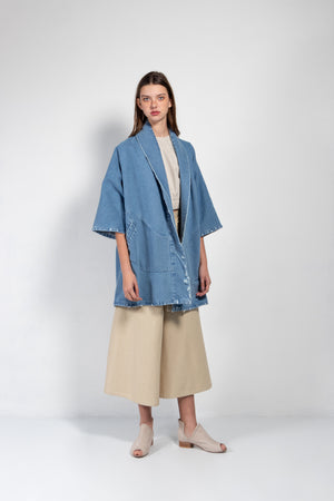 Women's distressed denim kimono in a medium wash