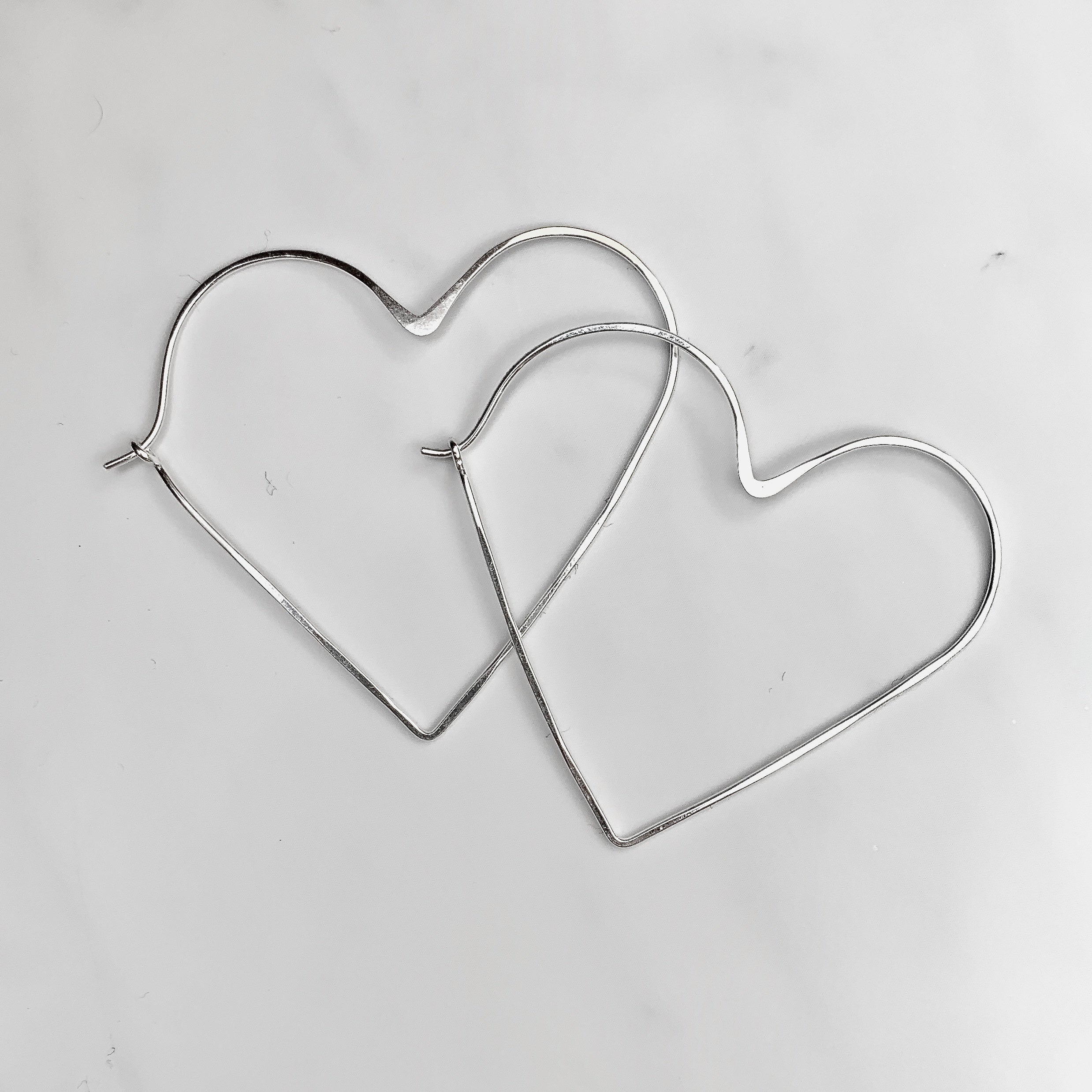 One (1) Silver Heart Hoop