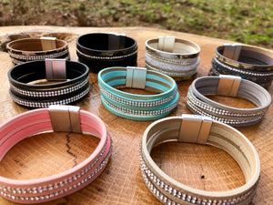 Layers of faux leather and crystals bracelets