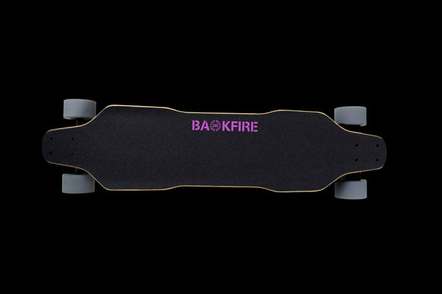 Backfire Zealot on Grip tape side with Backfire logo in pink