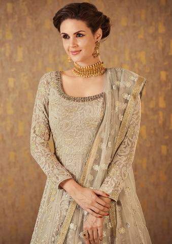 Add this gorgeous georgette beige party wear indo-western gown to your summer festive wardrobe to enhance your summer party wear experience
