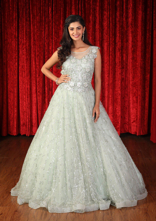 Pista Green Sequinned Net Designer Gown