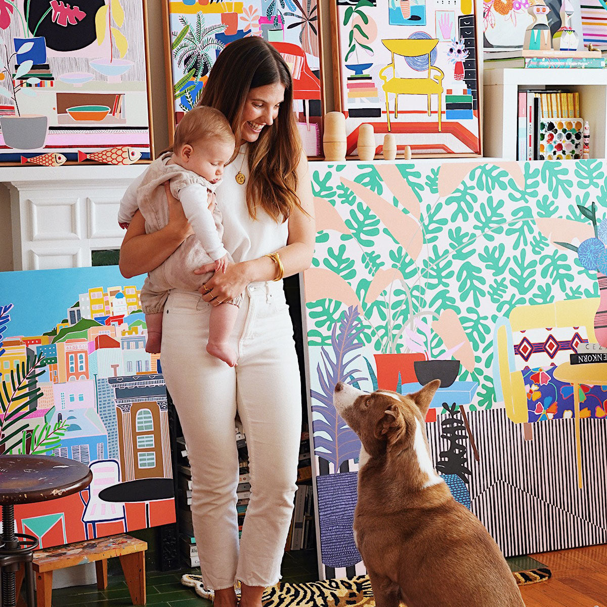 artist and her baby and dog in her studio