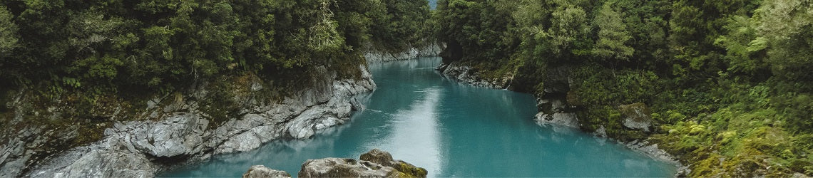 River with surrounding cliffs and trees in New Zealand | Evolve Inspired Jewellery