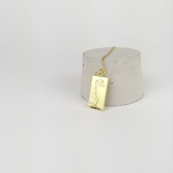 'In One Piece' Gold Pendant - By James Wilson
