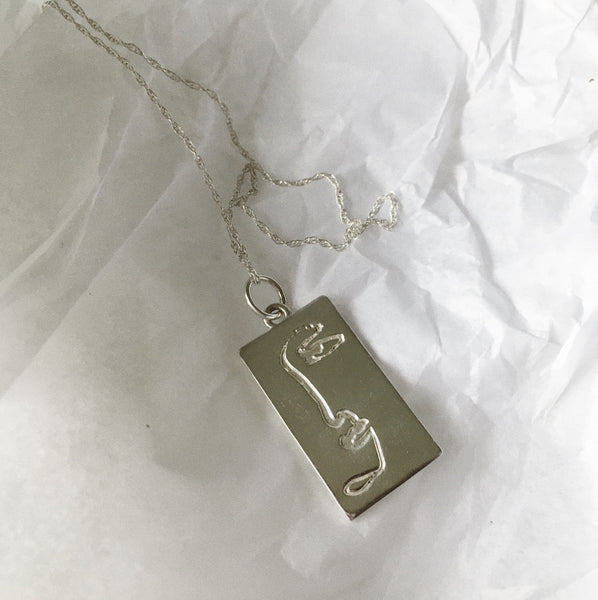 'In One Piece' Silver Pendant - By James Wilson