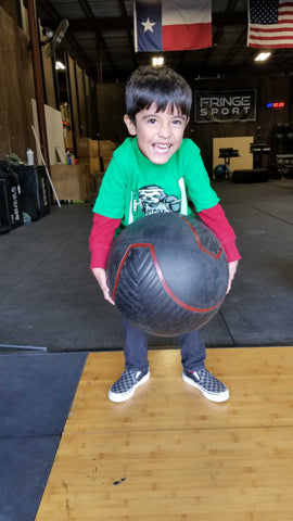 strongman for kids; kid lifting ball
