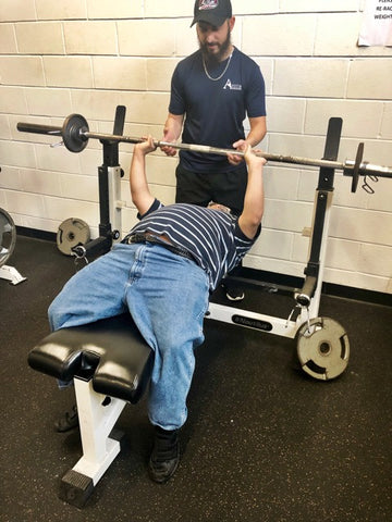 adaptive athlete bench pressing