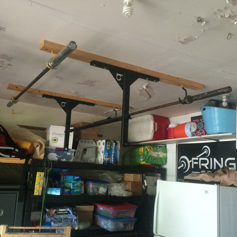 The completed DIY barbell storage solution