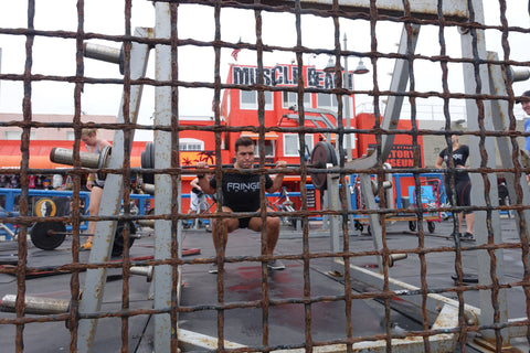 Peter Keller squatting at Muscle Beach