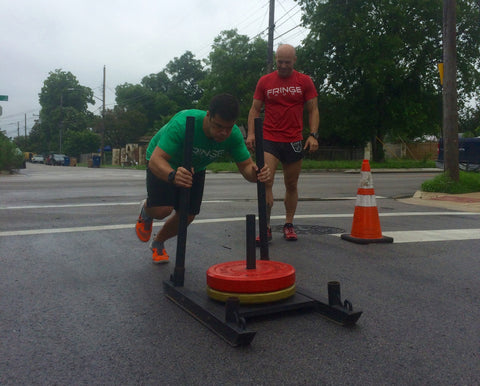 Weight on a prowler sled - pushing at Atomic Athlete