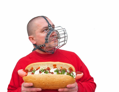 man with cage to stop eating unhealthy processed foods