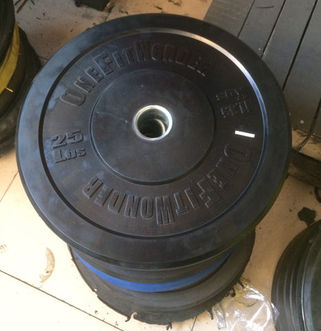 Bumper plates stacked for packing