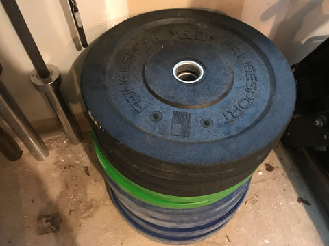 My bumper weight plate stack in my garage gym - I consider these essential