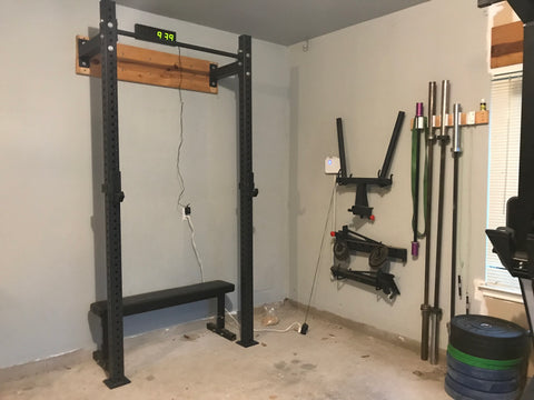 My squat rack in my garage gym, clean and essential!