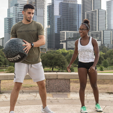 man and woman with medicine ball