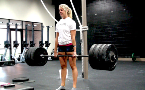 Teenage girl deadlifting like a champ- the barbell is bending!