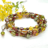 Brown and green glass beaded wrap bracelet handmade by impromptu jewelry