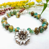 Green Czech bead bracelet with Hill Tribe Silver flowe handmade by impromptu jewelry