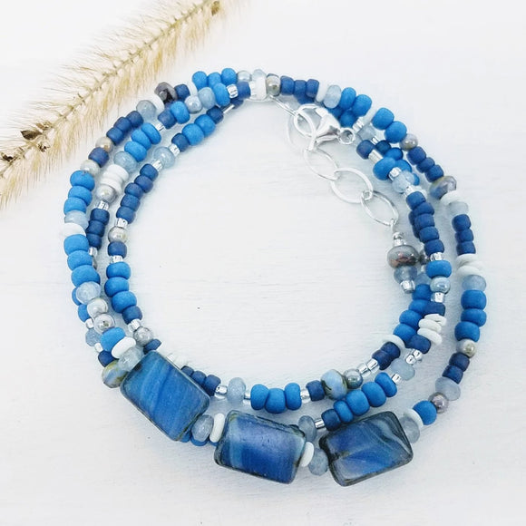 Blue monochromatic glass bead wrap bracelet doubles as a necklace handmade by impromptu jewelry