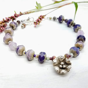 Purple Czech beaded bracelet with Hill tribe silver flower pendant