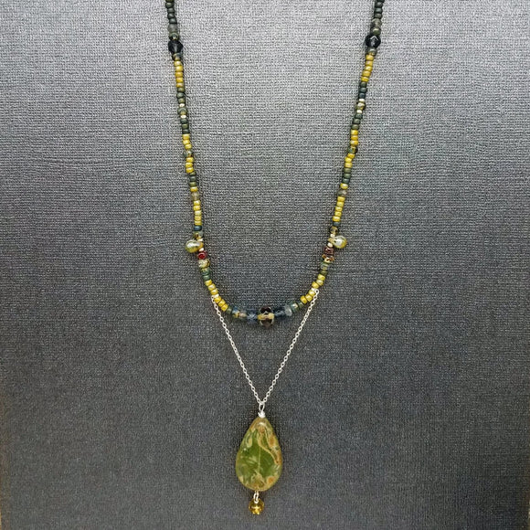 Green glass bead long necklace handmade by impromptu jewelry